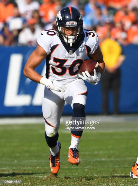 Phillip Lindsay of the Denver Broncos breaks through the line and runs for a touchdown in the second half of the game against the Los Angeles...