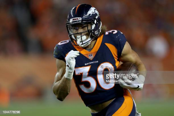 Phillip Lindsay of the Denver Broncos carries the ball against the Kansas City Chiefs at Broncos Stadium at Mile High on October 1 2018 in Denver...