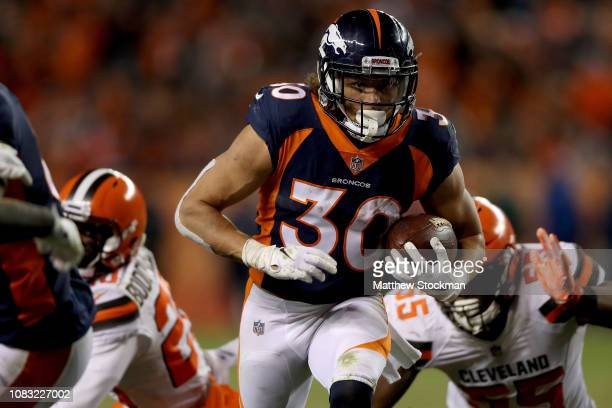 Phillip Lindsay of the Denver Broncos carries the ball against the Cleveland Browns at Broncos Stadium at Mile High on December 15 2018 in Denver...