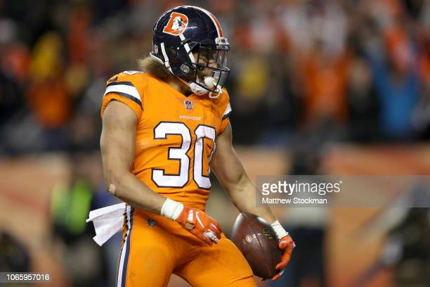 Phillip Lindsay of the Denver Broncos celebrates scoring a touchdown against the Pittsburgh Steelers at Broncos Stadium at Mile High on November 25...