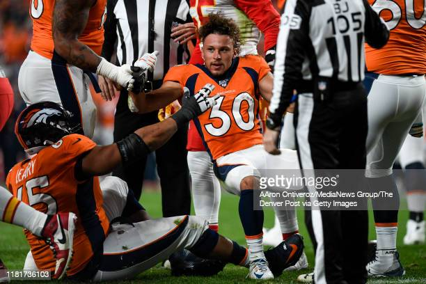 Phillip Lindsay of the Denver Broncos loses his helmet on a failed two-point conversion run against the Kansas City Chiefs during the first quarter...
