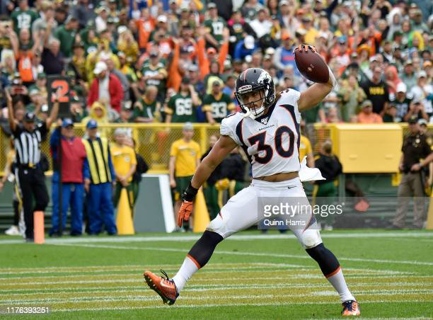 Phillip Lindsay of the Denver Broncos reacts after scoring a touchdown in the first quarter against the Green Bay Packers at Lambeau Field on...