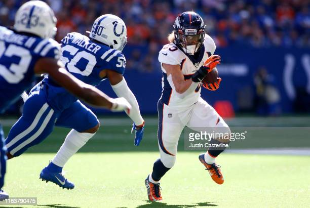Phillip Lindsay of the Denver Broncos runs the ball in the game against the Indianapolis Colts during the first quarter at Lucas Oil Stadium on...