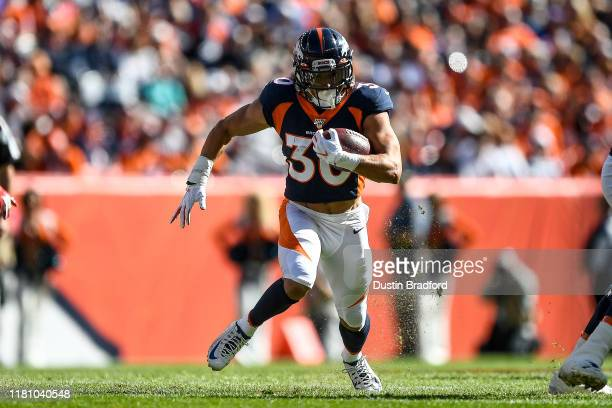 Phillip Lindsay of the Denver Broncos rushes against the Tennessee Titans in the first quarter of a game at Empower Field at Mile High on October 13,...