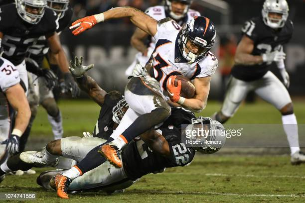 Phillip Lindsay of the Denver Broncos rushes with the ball against the Oakland Raiders during their NFL game at OaklandAlameda County Coliseum on...