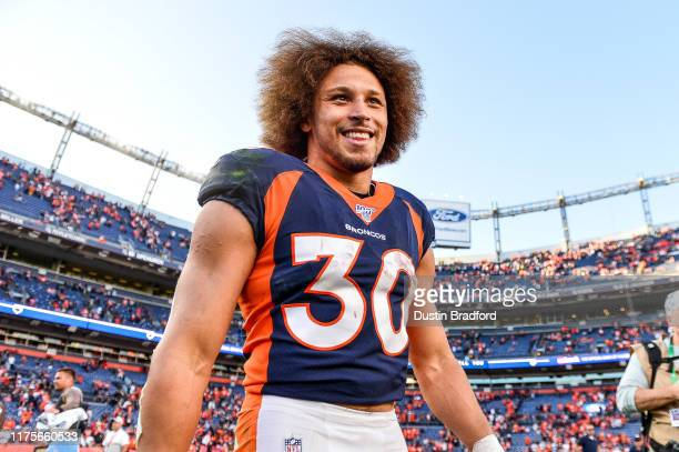 Phillip Lindsay of the Denver Broncos smiles as he walks on the field after the Denver Broncos 16-0 win over the Tennessee Titans at Empower Field at...