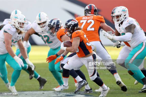 Phillip Lindsey of the Denver Broncos carries the ball against the Miami Dolphins at Empower Field At Mile High on November 22 2020 in Denver Colorado