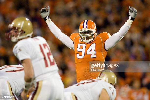 Phillip Merling of the Clemson Tigers gets the crowd fired up during the start of the game against the Boston College Eagles at Memorial Stadium...