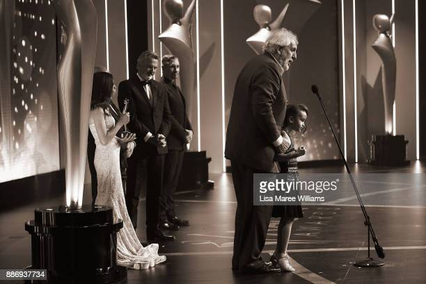 Phillip Noyce accepts the Longford Lyell Award with his daughter Ayanda Noyce during the 7th AACTA Awards Presented by Foxtel at The Star on December...