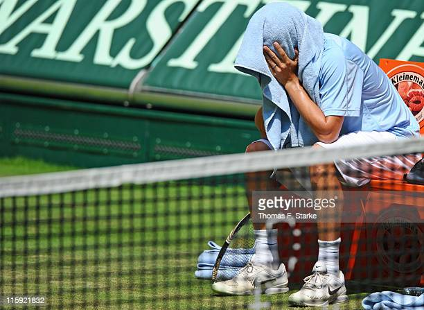 Phillip Petzchner sits on the bench after resigning in the final match against Philipp Kohlschreiber due to an injury after the Gerry Weber Open at...