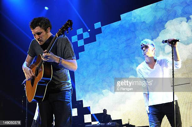 Phillip Phillips and Colton Dixon perform during the American Idol Live Summer Tour presented by Chips Ahoy and Ritz at Power Balance Pavilion on...