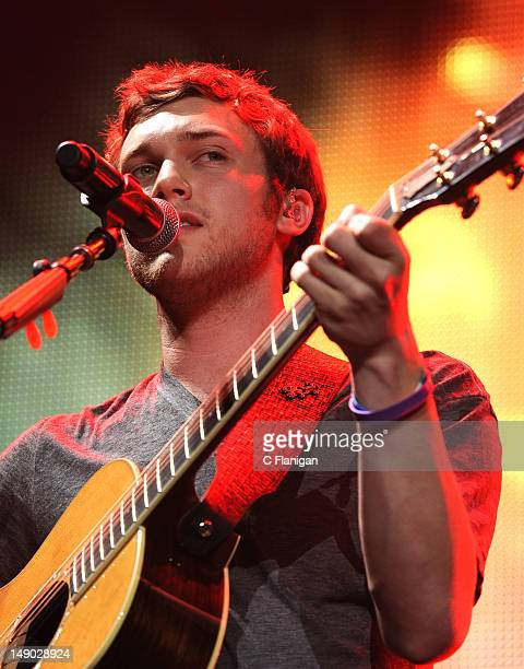 Phillip Phillips performs during the American Idol Live Summer Tour presented by Chips Ahoy and Ritz at Power Balance Pavilion on July 21 2012 in...