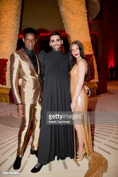 Phillip Picardi and Olivia Munn attend Heavenly Bodies Fashion The Catholic Imagination Costume Institute Gala at The Metropolitan Museum of Art on...