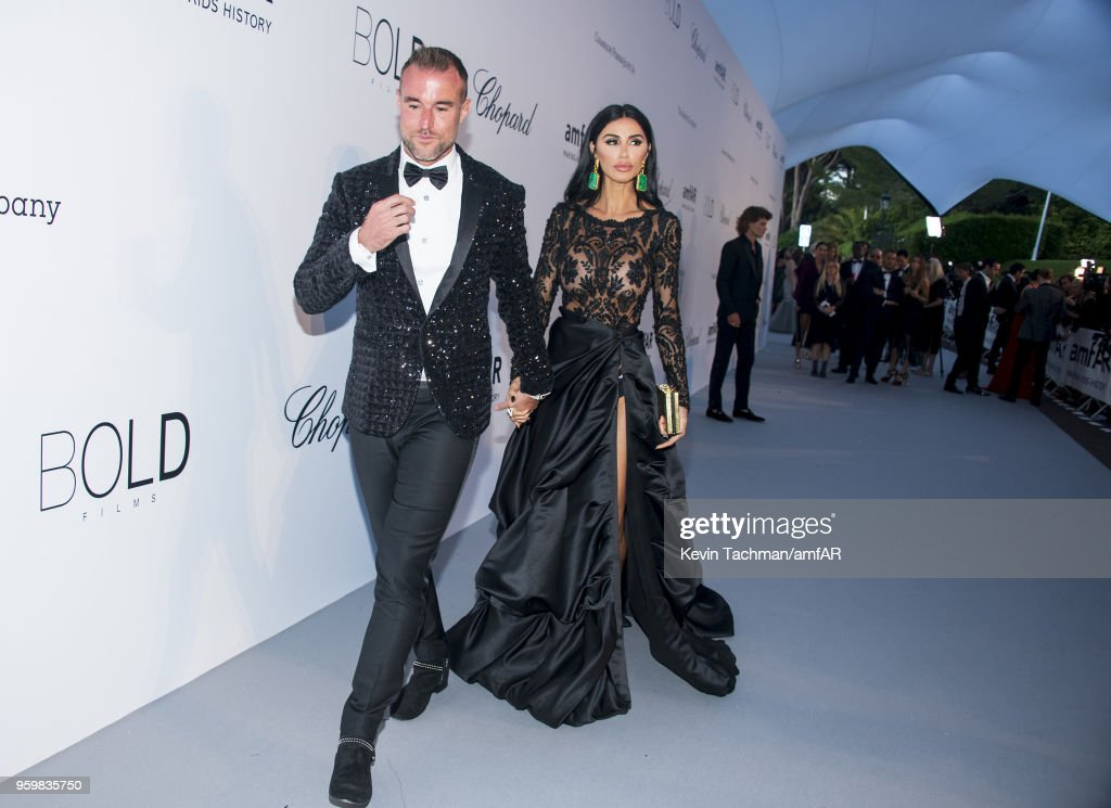 Phillip Plein and Morgan Osman arrive at the amfAR Gala Cannes 2018 at Hotel du Cap-Eden-Roc on May 17, 2018 in Cap d'Antibes, France.