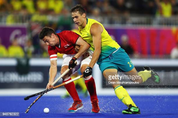 Phillip Roper of England battles for the ball with aTom Craig of Australia during Men's Semifinal match between Australia and England on day nine of...