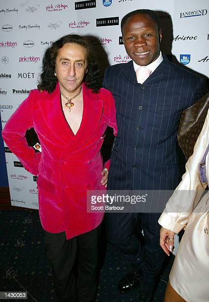 Phillip Salon and former boxer Chris Eubank arrive at the Pink Ribbon Fashion Show September 24 2002 in London United Kingdom