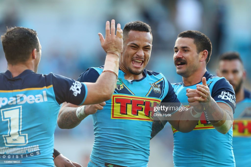Phillip Sami of the Titans celebrates a try with team mate Ash Taylor during the round 20 NRL match between the Gold Coast Titans and the New Zealand Warriors at Cbus Super Stadium on July 29, 2018 in Gold Coast, Australia.