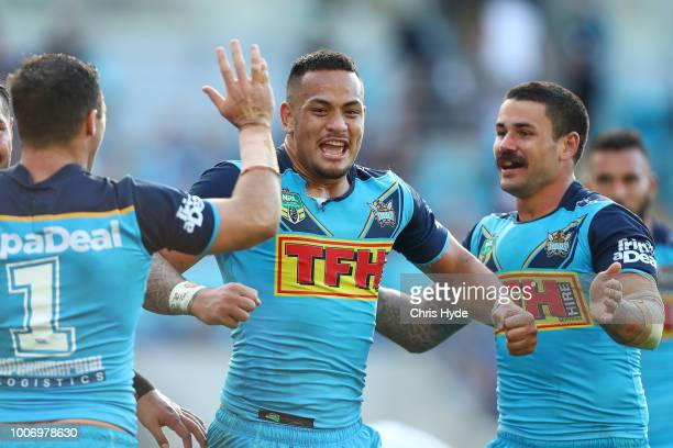 Phillip Sami of the Titans celebrates a try with team mate Ash Taylor during the round 20 NRL match between the Gold Coast Titans and the New Zealand...