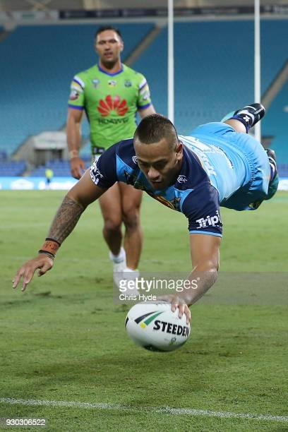 Phillip Sami of the Titans dives to score a try during the round one NRL match between the Gold Coast Titans and the Canberra Raiders at Cbus Super...