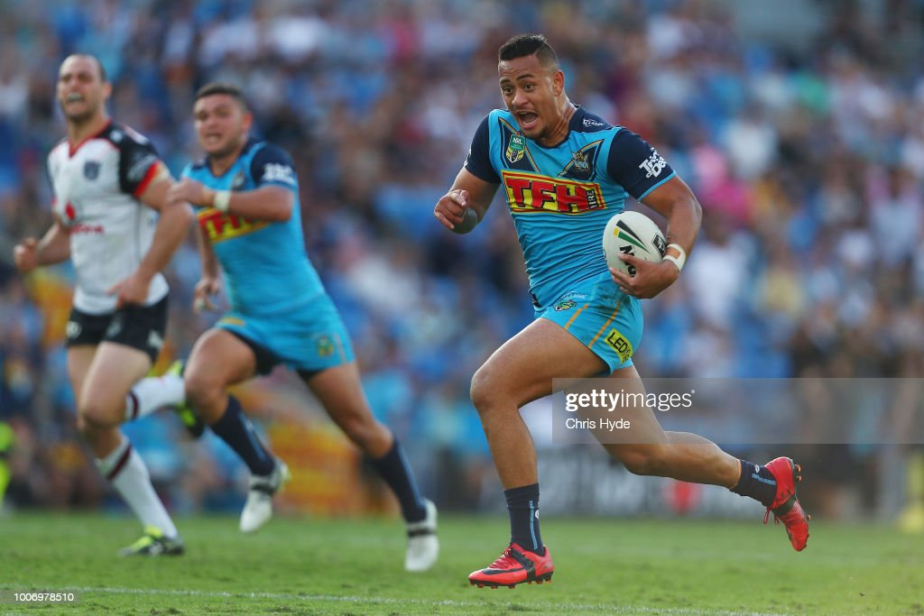 Phillip Sami of the Titans makes a break to score a try during the round 20 NRL match between the Gold Coast Titans and the New Zealand Warriors at Cbus Super Stadium on July 29, 2018 in Gold Coast, Australia.