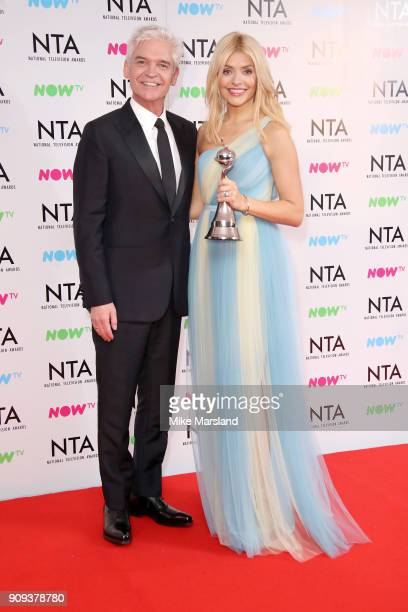 Phillip Schofield and Holly Willoughby from This Morning pose in the press room with the award for Daytime programme at the National Television...