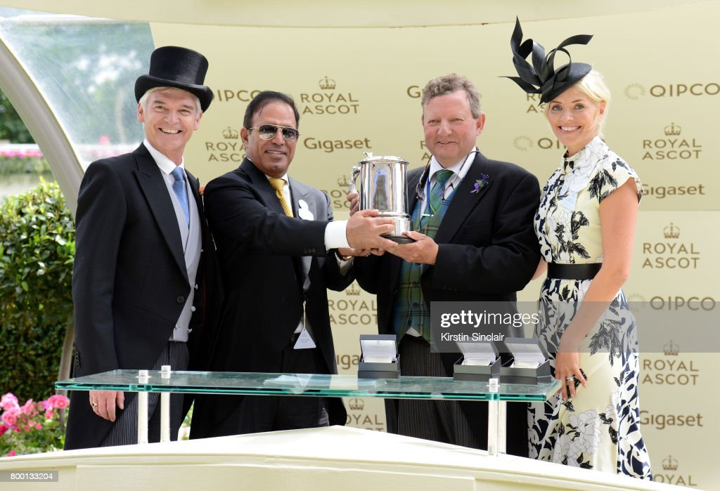 Phillip Schofield (L) and Holly Willoughby (R) present the King Edward VII Stakes to winners Abdulla Al Monsoon (2nd L) and Mark Johnston (2nd R) on day 4 of Royal Ascot at Ascot Racecourse on June 23, 2017 in Ascot, England.