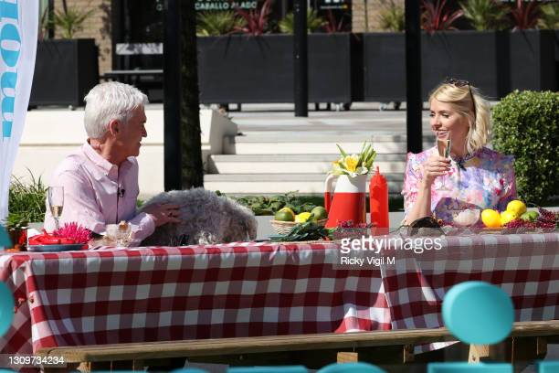 Phillip Schofield and Holly Willoughby seen filming This Morning outside on March 29, 2021 in London, England.