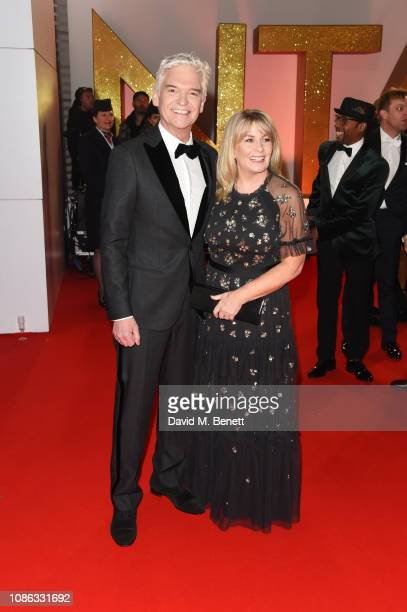 Phillip Schofield and Stephanie Lowe attend the National Television Awards held at The O2 Arena on January 22 2019 in London England