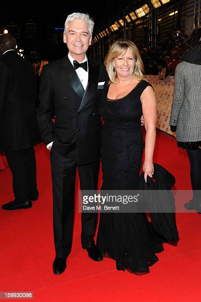 Phillip Schofield and Stephanie Lowe attends the the National Television Awards at 02 Arena on January 23 2013 in London England