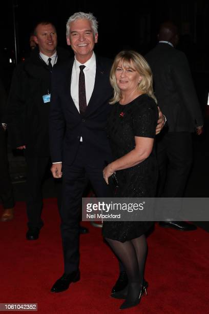 Phillip Schofield and Stephanie Lowe seen arriving at the Pride of Britain Awards at the Grosvenor Hotel on October 29 2018 in London England