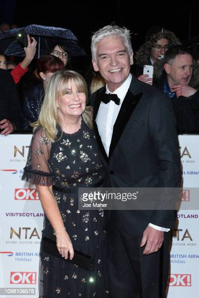 Phillip Schofield and wife Stephanie Lowe attend the National Television Awards held at The O2 Arena on January 22 2019 in London England