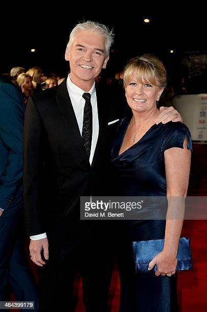 Phillip Schofield and wife Stephanie Lowe attend the National Television Awards at the 02 Arena on January 22 2014 in London England