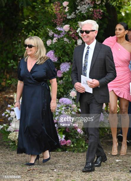 Phillip Schofield and wife Stephanie Lowe seen departing the wedding of Ant McPartlin and Anne-Marie Corbett at St Michael's Church in Heckfield on...