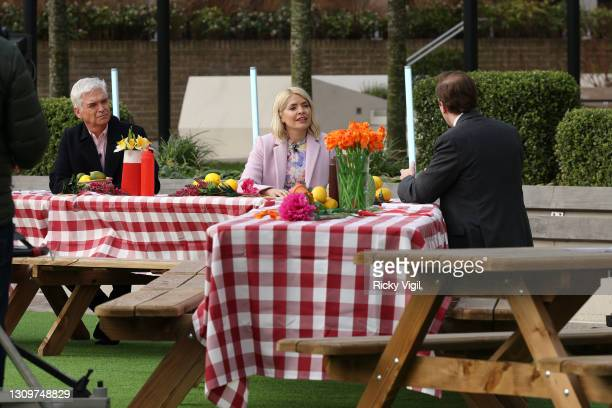 Phillip Schofield, Holly Willoughby and Matt Hancock seen filming This Morning outside on March 29, 2021 in London, England.