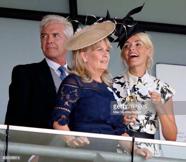 Phillip Schofield Stephanie Lowe and Holly Willoughby watch the racing as they attend day 4 of Royal Ascot at Ascot Racecourse on June 23 2017 in...