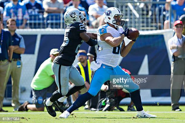 Phillip Supernaw of the Tennessee Titans catches a pass in front of DJ Hayden of the Oakland Raiders at Nissan Stadium on September 25, 2016 in...