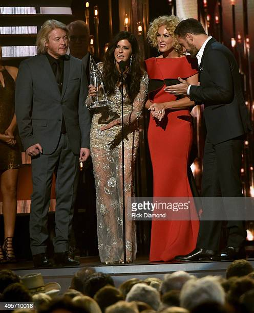 Phillip Sweet Karen Fairchild Kimberly Schlapman and Jimi Westbrook of Little Big Town accept the award for Single of the Year for the song Girl...