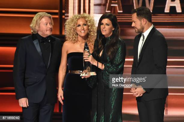 Phillip Sweet Kimberly Schlapman Karen Fairchild and Jimi Westbrook accept an award onstage at the 51st annual CMA Awards at the Bridgestone Arena on...