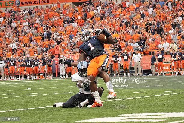 Phillip Thomas of the Syracuse Orange fights a tackle by De'ontray Johnson of the Rhode Island Rams during the game on September 10 2011 at the...
