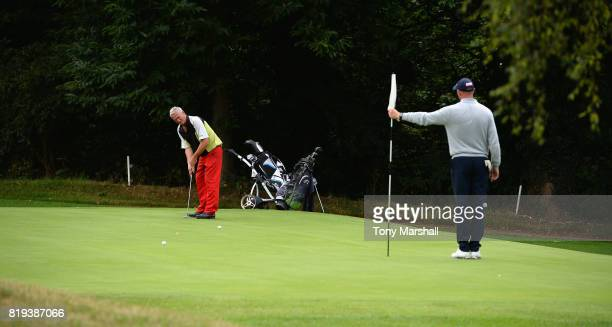 Phillip Tolley of Canons Brook Golf Club putts as James Blake of Canons Brook Golf Club tends the flag on the 17th green during the PGA Lombard...