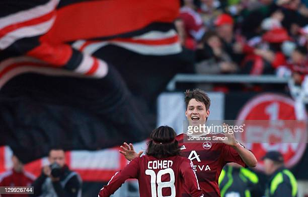 Phillip Wollscheid of Nuernberg celebrates with his team mate Almog Cohen after scoring his team's 2nd goal during the Bundesliga match between 1FC...