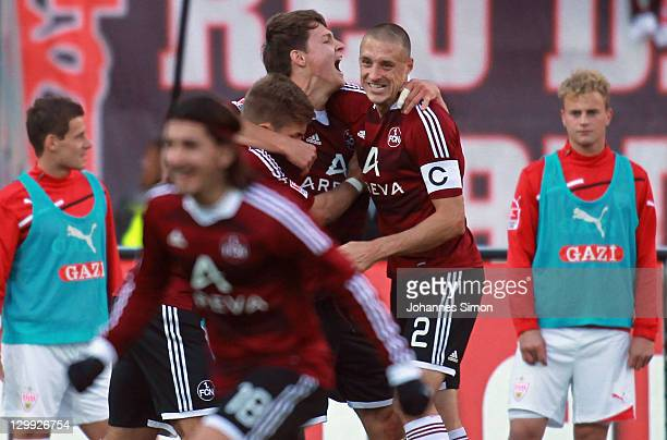 Phillip Wollscheid of Nuernberg celebrates with his team mates after scoring his team's 2nd goal during the Bundesliga match between 1FC Nuernberg...