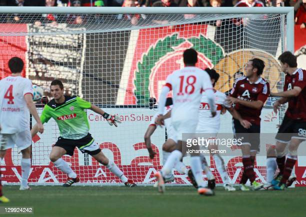 Phillip Wollscheid of Nuernberg scores his team mates after scoring his team's 2nd goal during the Bundesliga match between 1FC Nuernberg and VfB...