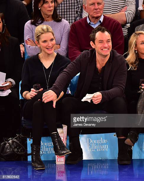 Phillipa Coan and Jude Law attend the Orlando Magic vs New York Knicks game at Madison Square Garden on February 26 2016 in New York City
