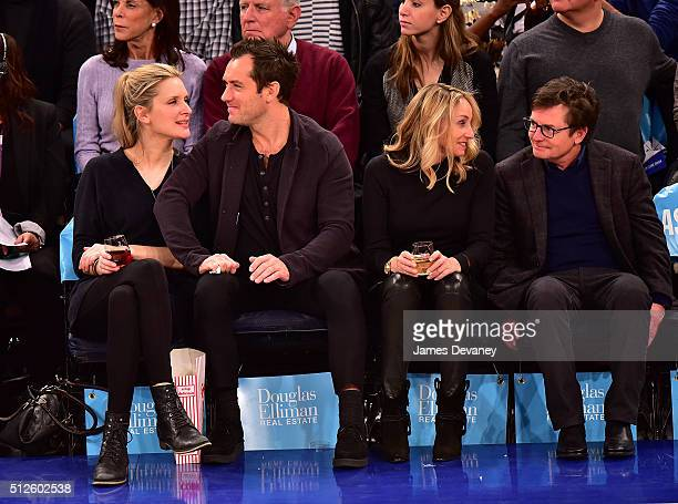 Phillipa Coan Jude Law Tracy Pollan and Michael J Fox attend the Orlando Magic vs New York Knicks game at Madison Square Garden on February 26 2016...