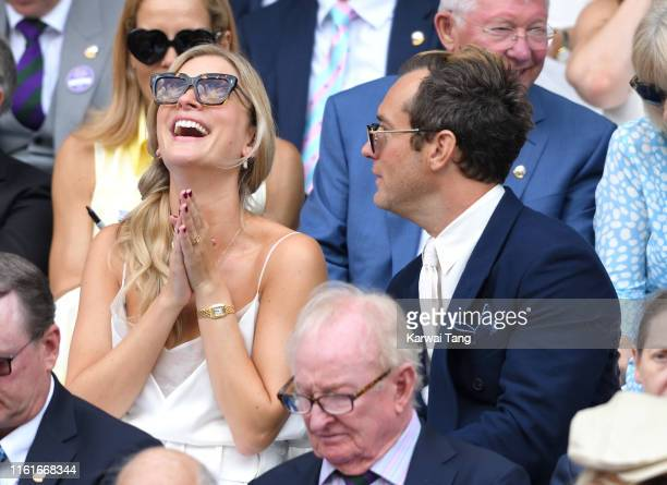 Phillipa Law and Jude Law attend day eleven of the Wimbledon Tennis Championships at All England Lawn Tennis and Croquet Club on July 12 2019 in...