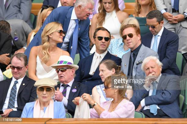 Phillipa Law, Sir Alex Ferguson, Princess Michael of Kent, Jude Law, Damian Lewis and Sir David Attenborough on Centre Court during day eleven of the...