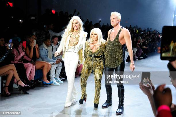 Phillipe Blond Lil' Kim and David Blond walk the runway at The Blonds during New York Fashion Week The Shows at Gallery I at Spring Studios on...