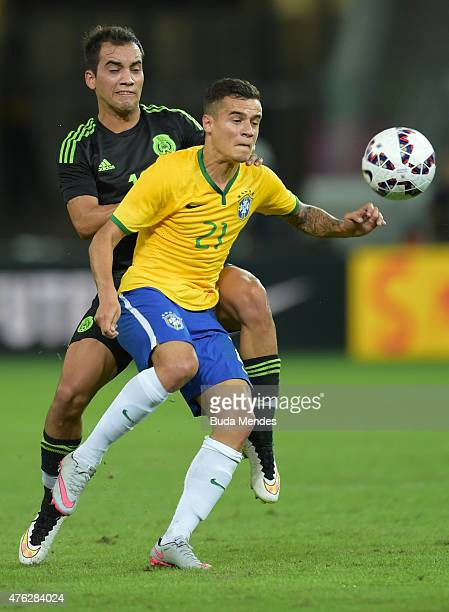 Phillipe Coutinho of Brazil and Adrián Aldrete of Mexico compete for the ball during the International Friendly Match between Brazil and Mexico at...