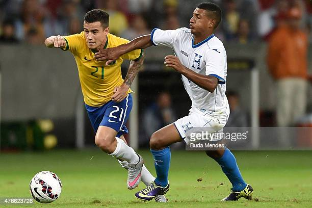 Phillipe Coutinho of Brazil and Bryan Acosta of Honduras compete for the ball during the International Friendly Match between Brazil and Honduras at...